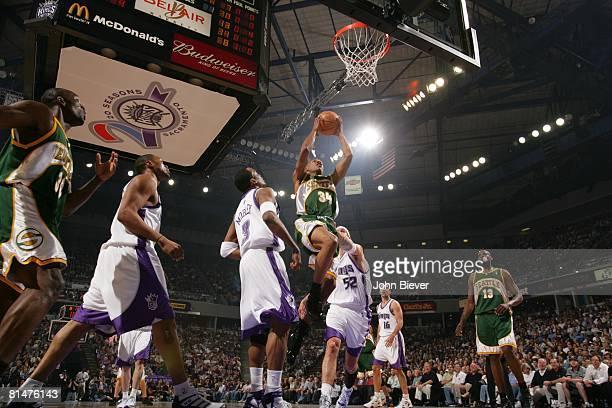 Basketball NBA playoffs Seattle SuperSonics Ray Allen in action taking layup vs Sacramento Kings Cuttino Mobley and Brad Miller Sacramento CA...