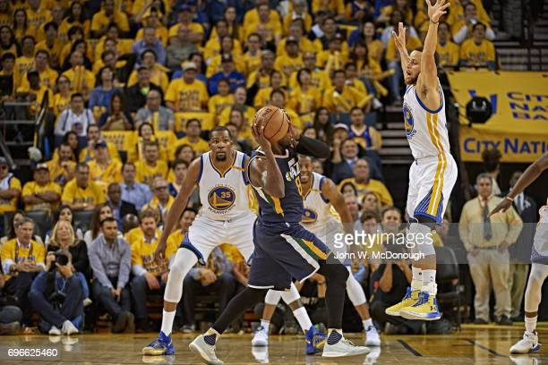 NBA Playoffs Utah Jazz Shelvin Mack in action vs Golden State Warriors Stephen Curry and Kevin Durant at Oracle Arena Game 2 Oakland CA CREDIT John W...