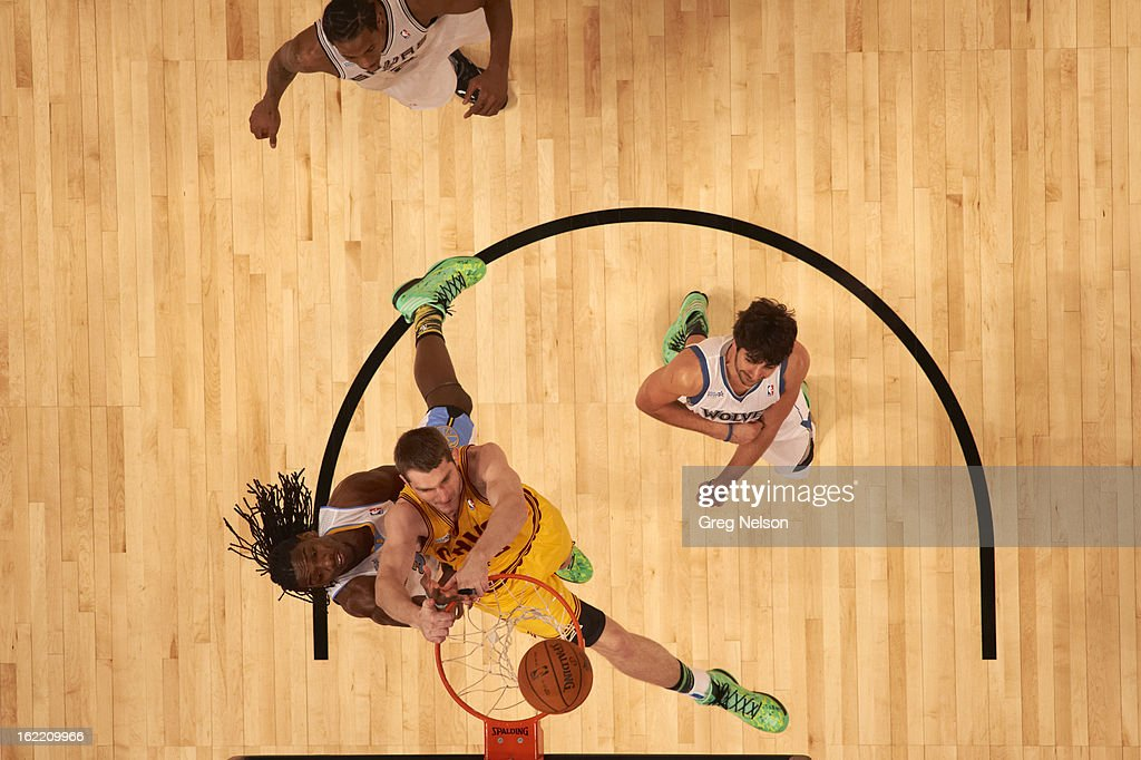 Aerial view of Cleveland Cavaliers Tyler Zeller (40) in action vs Denver Nuggets Kenneth Faried (35) during All-Star Weekend at Toyota Center. Greg Nelson F87 )