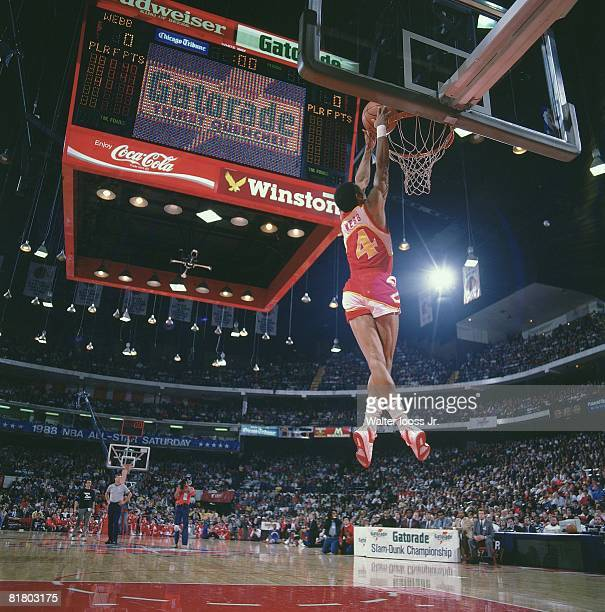 Basketball NBA Slam Dunk Contest Atlanta Hawks Spud Webb in action making dunk during All Star Weekend View of scoreboard at Chicago Stadium Chicago...