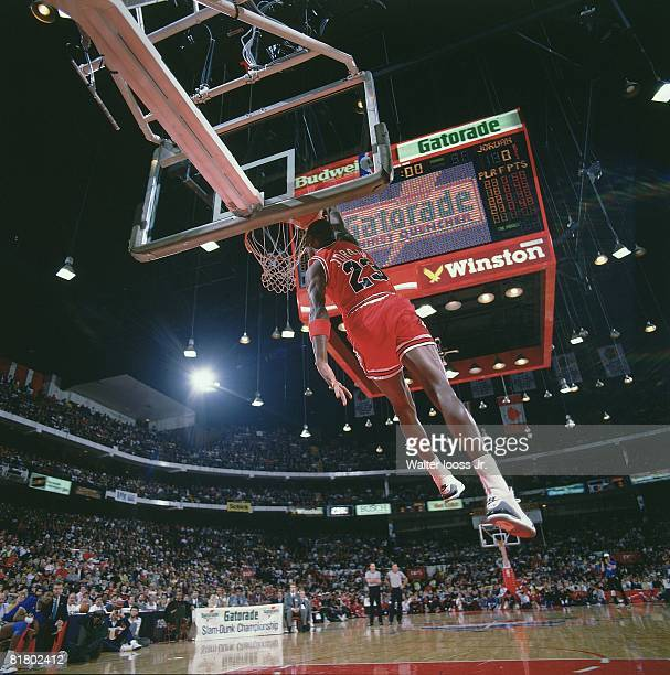 Basketball NBA Slam Dunk Contest Chicago Bulls Michael Jordan in action making dunk during All Star Weekend View of scoreboard at Chicago Stadium...