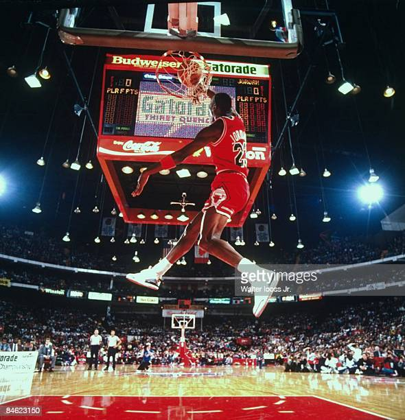 NBA Slam Dunk Contest Chicago Bulls Michael Jordan in action making dunk during All Star Weekend View of scoreboard at Chicago Stadium Chicago IL...