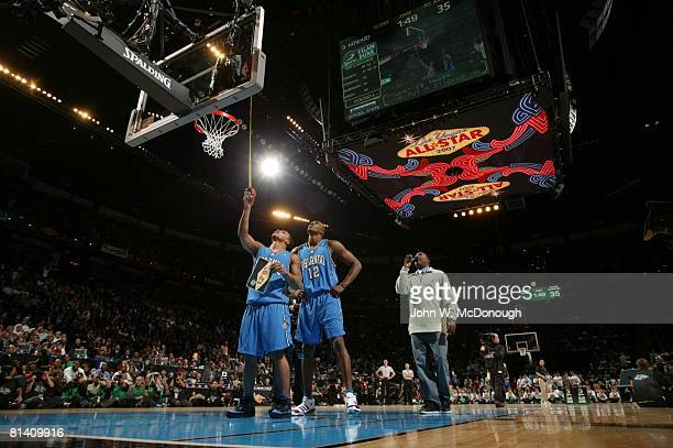 Basketball NBA Slam Dunk Contest Orlando Magic Jameer Nelson measures sticker placed on backboard after dunk by Dwight Howard during All Star Weekend...