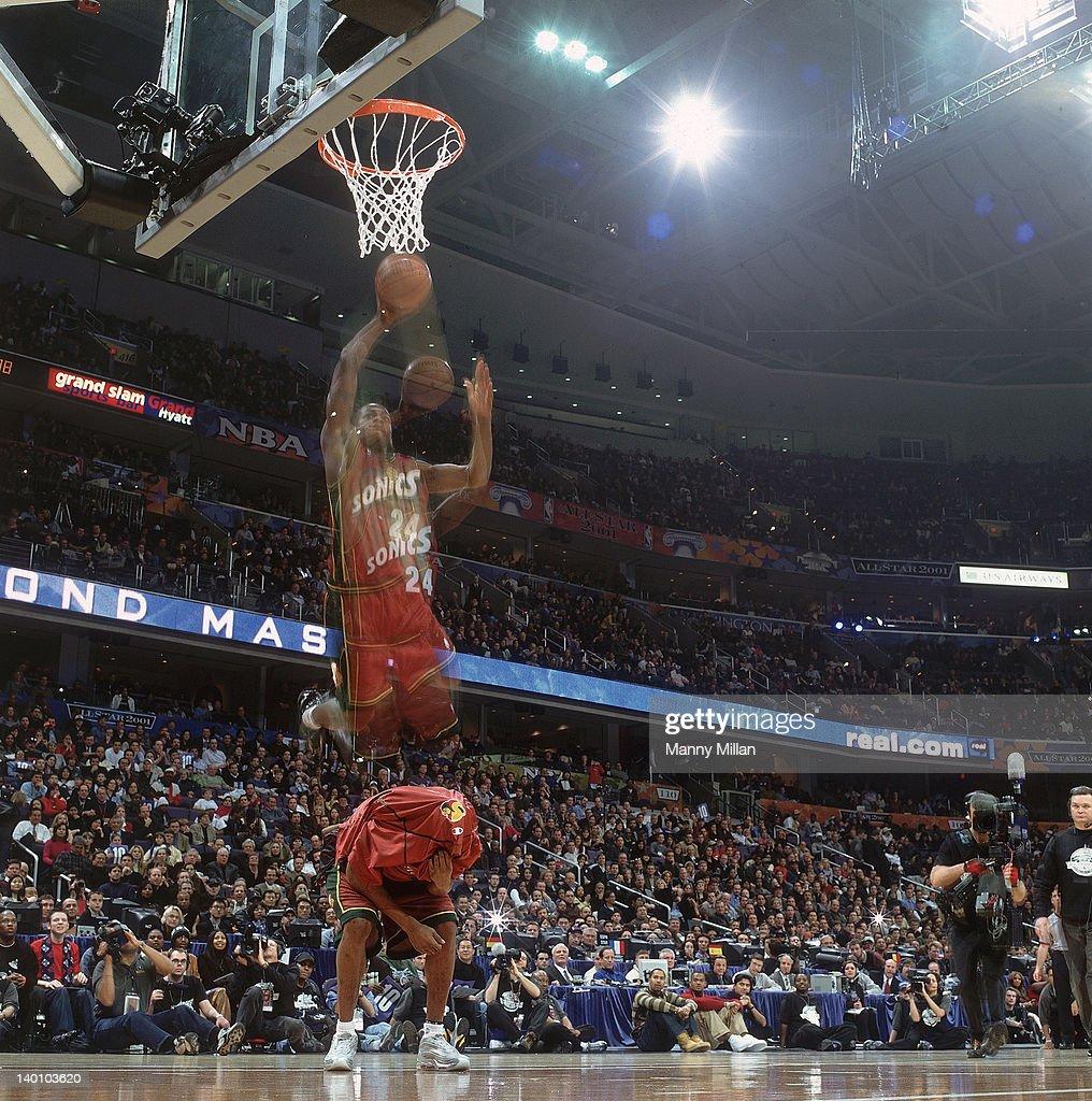 NBA Slam Dunk Contest Seattle SuperSonics Desmond Mason making dunk over his teammate Rashard Lewis during All Star Weekend at MCI Center Washington...