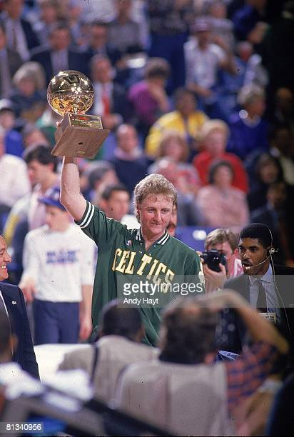 Basketball NBA Three Point Contest Boston Celtics Larry Bird victorious with trophy after winning competition during All Star Weekend Seattle WA...