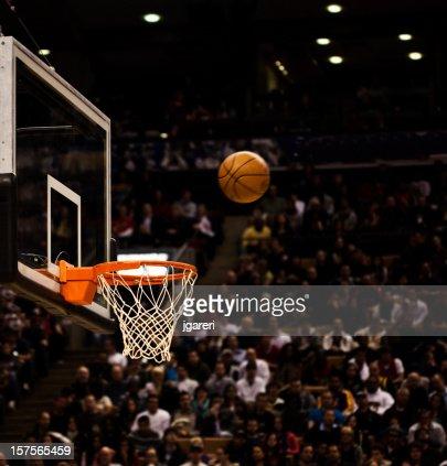 Basketball net with basketball near hoop
