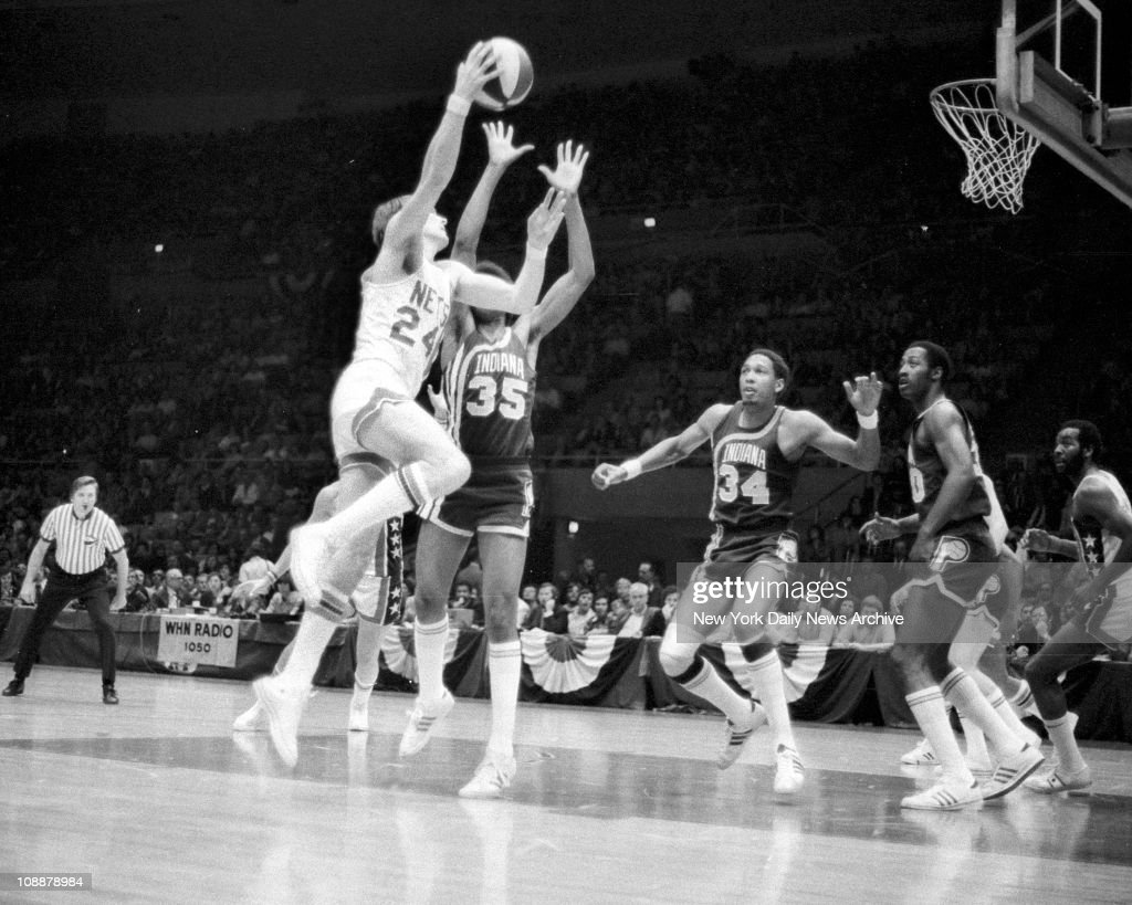 Basketball Nets vs Indiana Rick Barry shoots over Pacers Roger