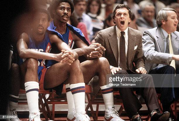 Basketball New Jersey Nets coach Larry Brown and Buck Williams upset during game vs New York Knicks New York NY