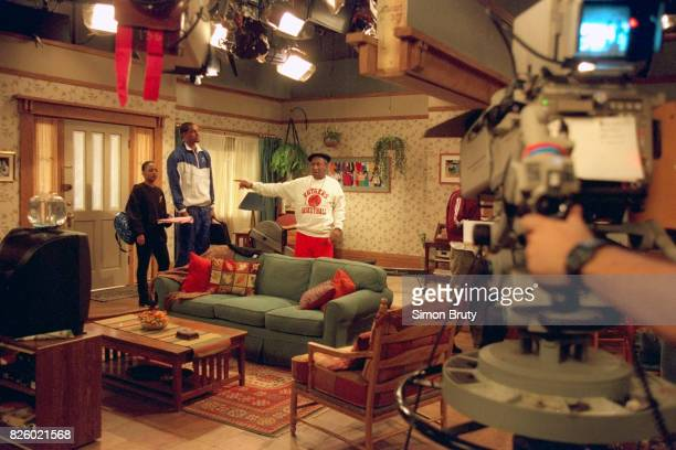 New Jersey Nets Jayson Williams shooting scene with actor and comedian Bill Cosby during taping of his special appearance on the set of the show...