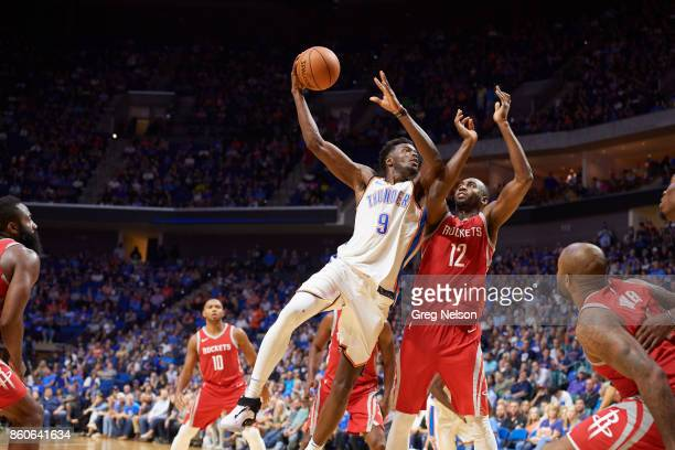 Oklahoma City Thunder Jerami Grant in action vs Houston Rockets Luc Mbah a Moute during preseason game at BOK Center Tulsa OK CREDIT Greg Nelson