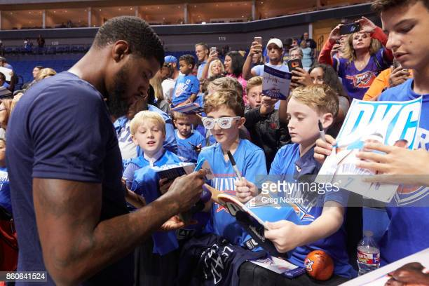 Oklahoma City Thunder Paul George signing autographs for young fans in stands before preseason game vs Houston Rockets at BOK Center Tulsa OK CREDIT...