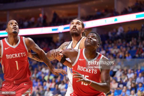Oklahoma City Thunder Steven Adams in action vs Houston Rockets Trevor Ariza and Clint capela during preseason game at BOK Center Tulsa OK CREDIT...