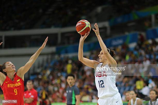 Day 15 Diana Taurasi of United States shoots a three point basket as Laia Palau of Spain defends during the USA Vs Spain Women's Basketball Final at...