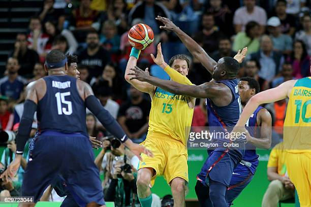 Day 5 David Andersen of Australia is defended by Draymond Green of United States during the USA Vs Australia game in the Men's Basketball Tournament...