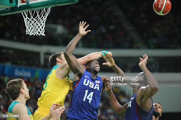 Day 5 Draymond Green of United States is hit by David Andersen of Australia as they attempt to rebound watched by Kevin Durant of United States...