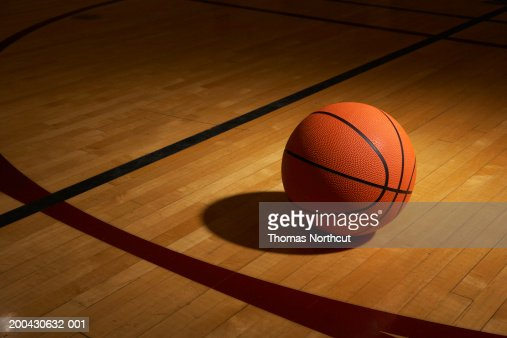 Basketball on basketball court, elevated view