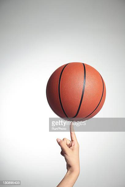 Basketball on index finger,hands close-up