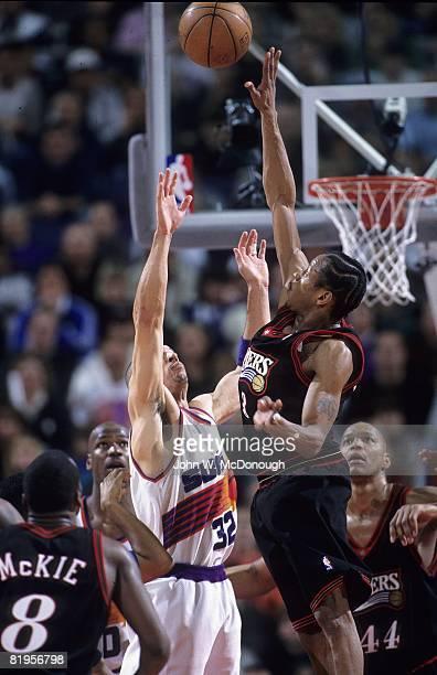 Philadelphia 76ers Allen Iverson in action out jumps Phoenix Suns Jason Kidd Phoenix AZ 2/24/1998 CREDIT John W McDonough