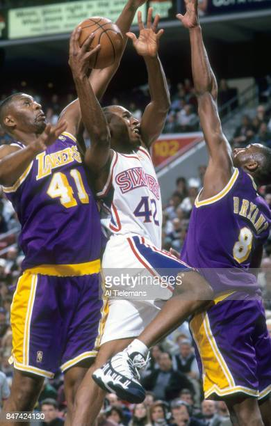 Philadelphia 76ers Jerry Stackhouse in action vs Los Angeles Lakers Elden Campbell and Kobe Bryant at CoreStates Center Philadelphia PA CREDIT Al...