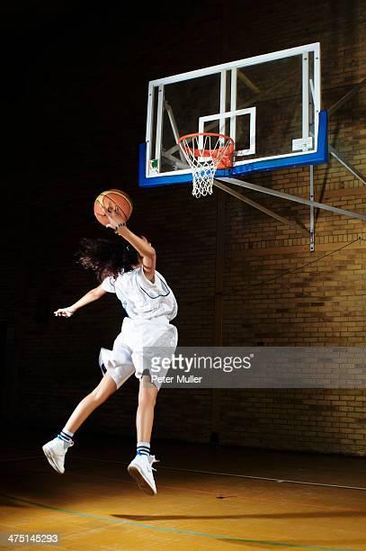 Basketball player aiming at hoop