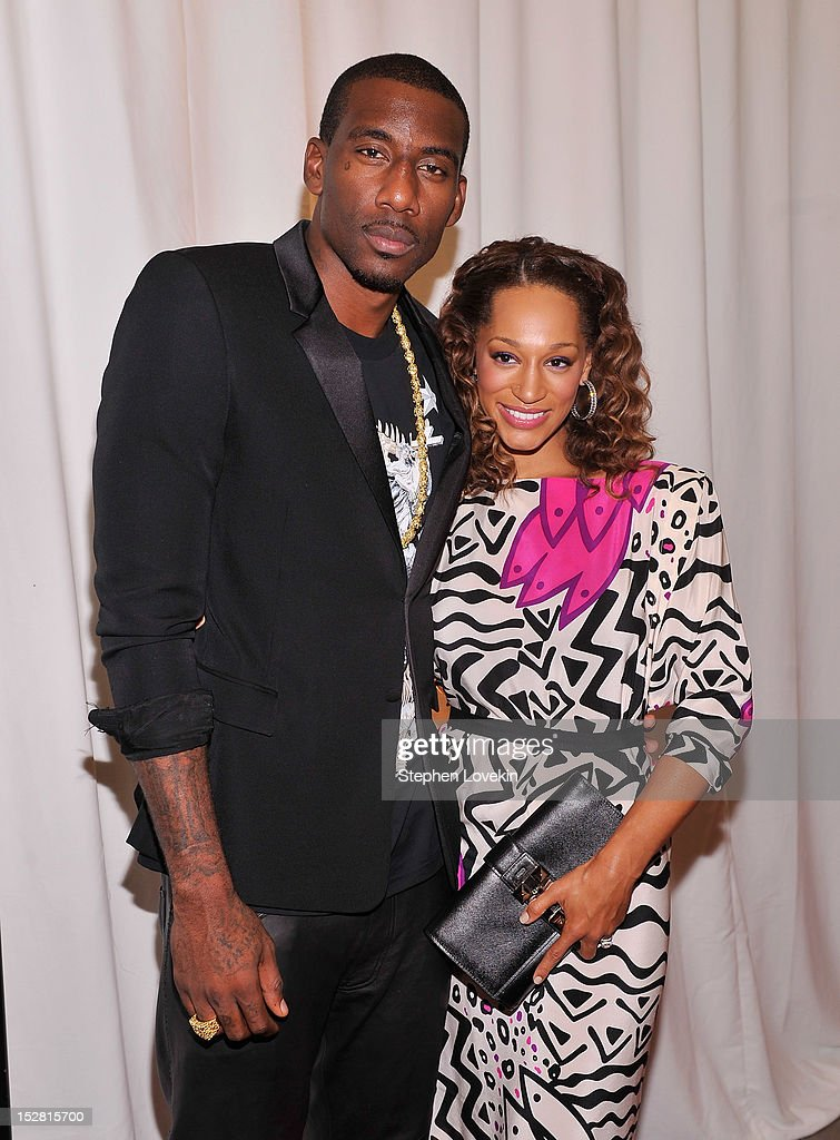 NBA basketball player Amare Stoudemire and Alexis Welch attend the 'A Year In A New York Minute' photo exhibition at Canoe Studios on September 26, 2012 in New York City.