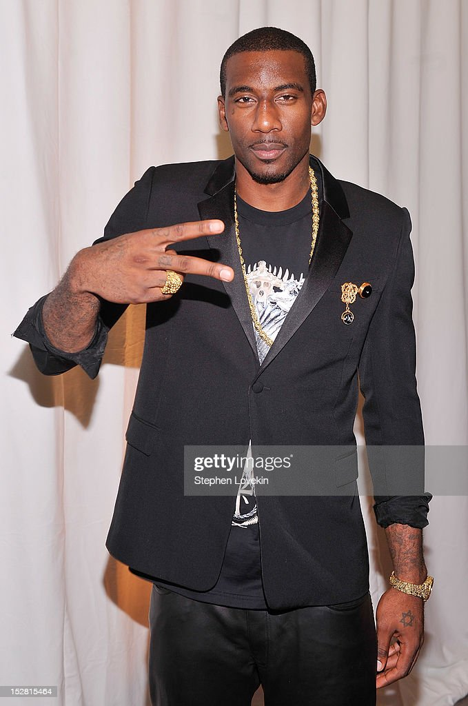 NBA basketball player Amare Stoudemire attends the 'A Year In A New York Minute' photo exhibition at Canoe Studios on September 26, 2012 in New York City.