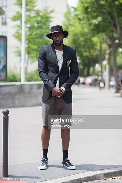 Basketball player Amare Stoudemire wears a Saint Laurent Paris hat Ovadia Sons jacket Rolex watch and Rick Owens shorts on June 25 2015 in Paris...
