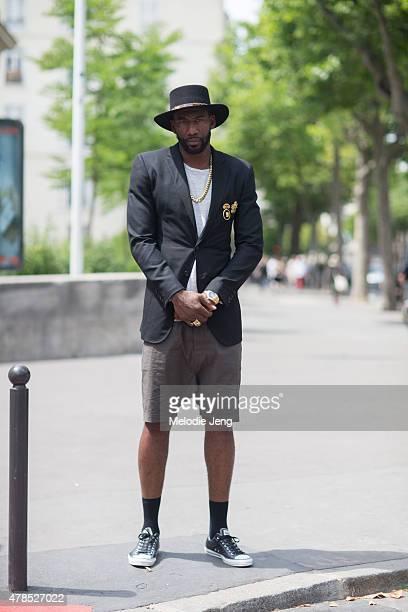 Basketball player Amare Stoudemire wears a Saint Laurent Paris hat Ovadia Sons jacket Rolex watch and Rick Owens shorts on June 25 2015 in Paris...