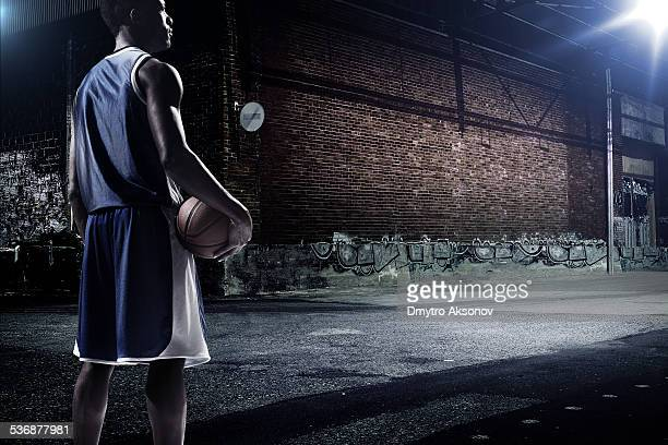 Basketball player at an outdoor place