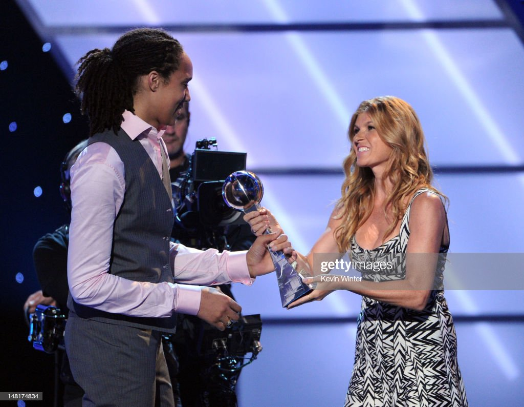 Basketball player Brittney Griner accepts the Best Female Athlete award from actress Connie Britton onstage during the 2012 ESPY Awards at Nokia...