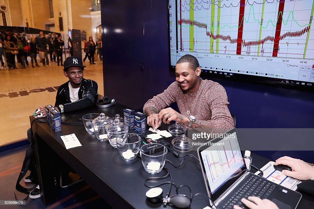 Basketball player Carmelo Anthony (R) and guest appear as Carmelo Anthony brings the heat in the Gillette Clinical Clear Gel Pressure Chamber, taking guys out of their comfort zones with polygraph test questions that will push their deodorant to its limit in Vanderbilt Hall at Grand Central Terminal on April 28, 2016 in New York City.