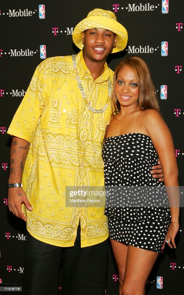 NBA basketball player <a gi-track='captionPersonalityLinkClicked' href=/galleries/search?phrase=Carmelo+Anthony&family=editorial&specificpeople=201494 ng-click='$event.stopPropagation()'>Carmelo Anthony</a> and MTV VJ Lala attend the T-Mobile Basketball's Rising Stars Celebration at Tao Restaurant on June 28, 2006 in New York City.