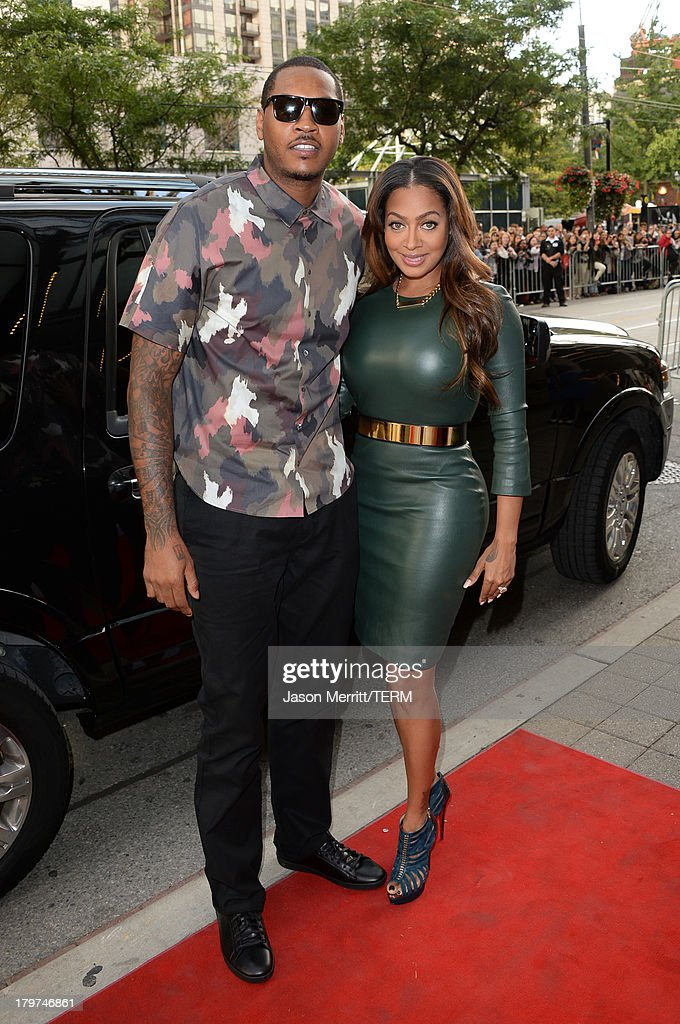 Basketball player <a gi-track='captionPersonalityLinkClicked' href=/galleries/search?phrase=Carmelo+Anthony&family=editorial&specificpeople=201494 ng-click='$event.stopPropagation()'>Carmelo Anthony</a> (L) and wife <a gi-track='captionPersonalityLinkClicked' href=/galleries/search?phrase=La+La+Anthony&family=editorial&specificpeople=209433 ng-click='$event.stopPropagation()'>La La Anthony</a> arrives at the '12 Years A Slave' premiere during the 2013 Toronto International Film Festival at the Princess of Wales Theatre on September 6, 2013 in Toronto, Canada.