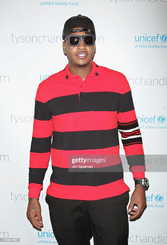 Basketball Player <a gi-track='captionPersonalityLinkClicked' href=/galleries/search?phrase=Carmelo+Anthony&family=editorial&specificpeople=201494 ng-click='$event.stopPropagation()'>Carmelo Anthony</a> attends 'A Year In A New York Minute' Photo Exhibition at Canoe Studios on September 26, 2012 in New York City.