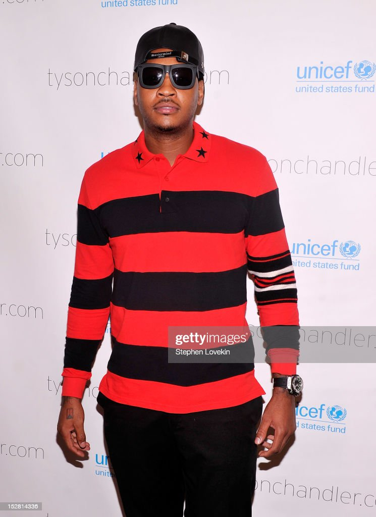 NBA basketball player <a gi-track='captionPersonalityLinkClicked' href=/galleries/search?phrase=Carmelo+Anthony&family=editorial&specificpeople=201494 ng-click='$event.stopPropagation()'>Carmelo Anthony</a> attends the 'A Year In A New York Minute' photo exhibition at Canoe Studios on September 26, 2012 in New York City.