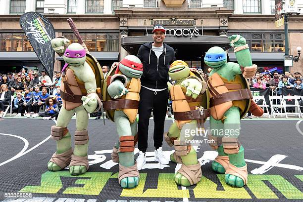 Basketball player Carmelo Anthony poses with the Teenage Mutant Ninja Turtles at Macy's Herald Square for the Launch of TMNT X Melo on May 21 2016 in...
