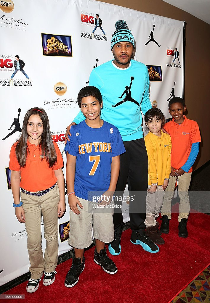 NBA basketball player <a gi-track='captionPersonalityLinkClicked' href=/galleries/search?phrase=Carmelo+Anthony&family=editorial&specificpeople=201494 ng-click='$event.stopPropagation()'>Carmelo Anthony</a> with young fans attend the 'Big' 25th Anniversary Edition Blu-ray Release special screening benefiting the <a gi-track='captionPersonalityLinkClicked' href=/galleries/search?phrase=Carmelo+Anthony&family=editorial&specificpeople=201494 ng-click='$event.stopPropagation()'>Carmelo Anthony</a> Foundation at AMC Empire on December 20, 2013 in New York City.