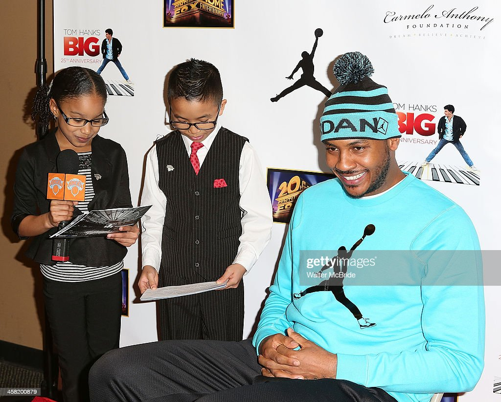 NBA basketball player <a gi-track='captionPersonalityLinkClicked' href=/galleries/search?phrase=Carmelo+Anthony&family=editorial&specificpeople=201494 ng-click='$event.stopPropagation()'>Carmelo Anthony</a> with young Knicks Journalists attend the 'Big' 25th Anniversary Edition Blu-ray Release special screening benefiting the <a gi-track='captionPersonalityLinkClicked' href=/galleries/search?phrase=Carmelo+Anthony&family=editorial&specificpeople=201494 ng-click='$event.stopPropagation()'>Carmelo Anthony</a> Foundation at AMC Empire on December 20, 2013 in New York City.