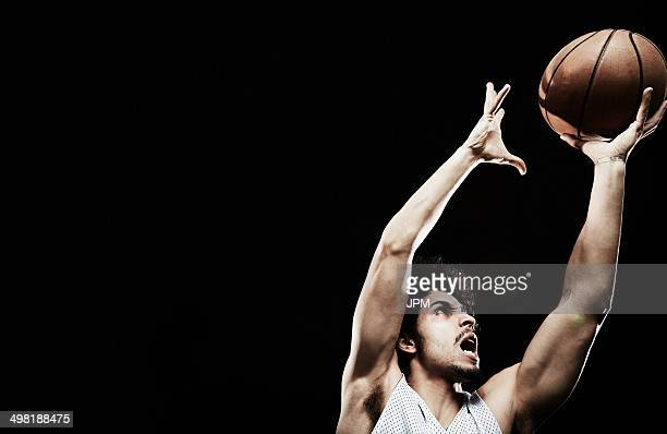 Basketball player catching basketball
