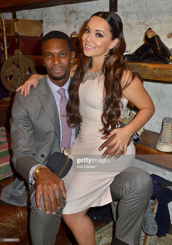 Basketball player Chris Bosh and Adrienne Williams Bosh attend Chris Bosh and Hennessy VS Raise a Glass to Mr Nice Tie at Carson Street Clothiers on...