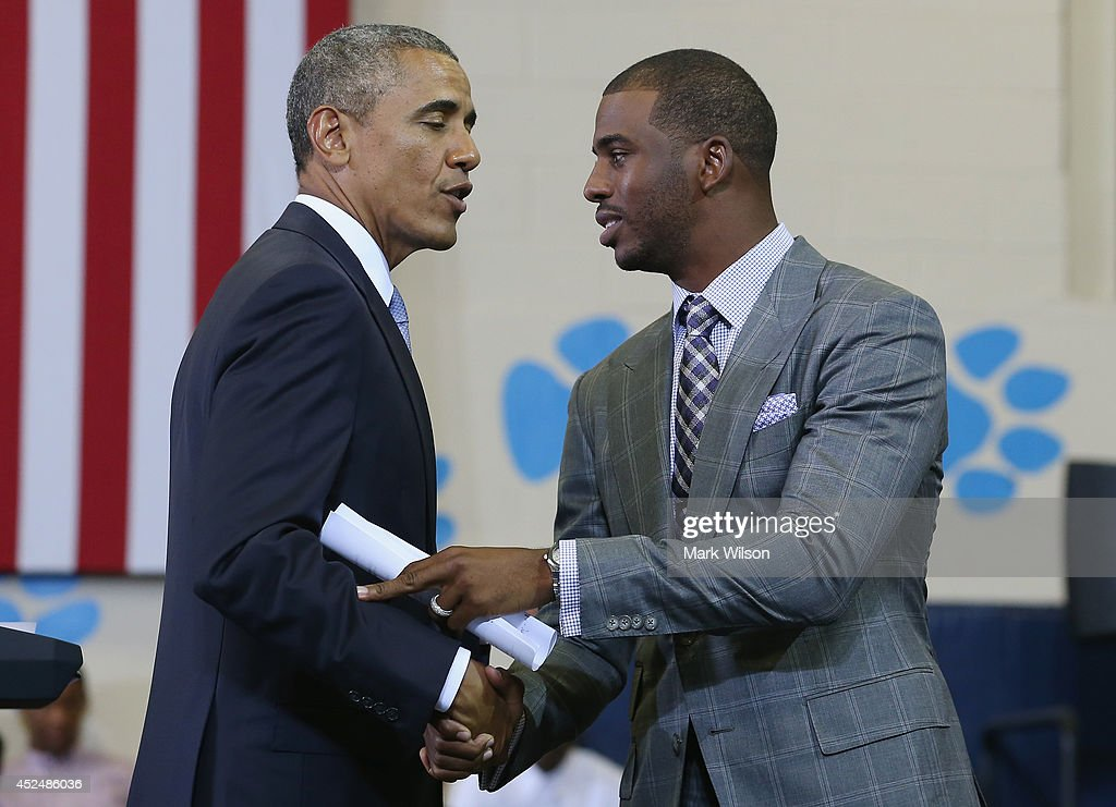 Basketball player <a gi-track='captionPersonalityLinkClicked' href=/galleries/search?phrase=Chris+Paul&family=editorial&specificpeople=212762 ng-click='$event.stopPropagation()'>Chris Paul</a> (R) Los Angeles Clippers introduces U.S. President <a gi-track='captionPersonalityLinkClicked' href=/galleries/search?phrase=Barack+Obama&family=editorial&specificpeople=203260 ng-click='$event.stopPropagation()'>Barack Obama</a> at the Walker Jones Education Campus, on July 21, 2014 in Washington, DC. President Obama spoke to area youth about My Brothers Keeper Initiative during a town hall meeting.