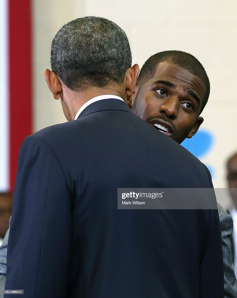 Basketball player <a gi-track='captionPersonalityLinkClicked' href=/galleries/search?phrase=Chris+Paul&family=editorial&specificpeople=212762 ng-click='$event.stopPropagation()'>Chris Paul</a> Los Angeles Clippers talks with U.S. President <a gi-track='captionPersonalityLinkClicked' href=/galleries/search?phrase=Barack+Obama&family=editorial&specificpeople=203260 ng-click='$event.stopPropagation()'>Barack Obama</a> at the Walker Jones Education Campus, on July 21, 2014 in Washington, DC. President Obama spoke to area youth about My Brothers Keeper Initiative during a town hall meeting.