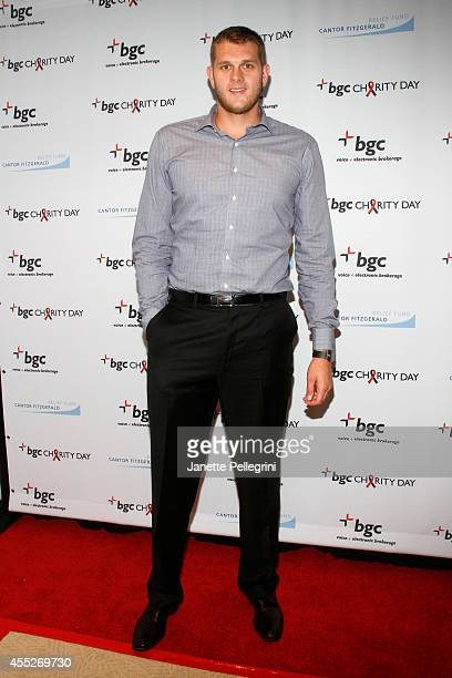 Basketball player Cole Aldrich attends Annual Charity Day Hosted By Cantor Fitzgerald And BGC at BGC Partners INC on September 11 2014 in New York...