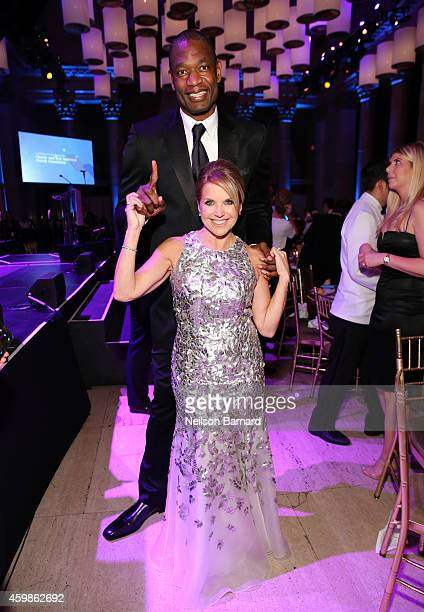 Basketball player Dikembe Mutombo and journalist Katie Couric attend the Tenth Annual UNICEF Snowflake Ball at Cipriani Wall Street on December 2...
