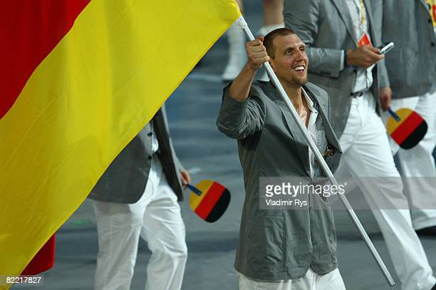 Basketball player Dirk Nowitzki of Germany carries his country's flag during the Opening Ceremony for the 2008 Beijing Summer Olympics at the...