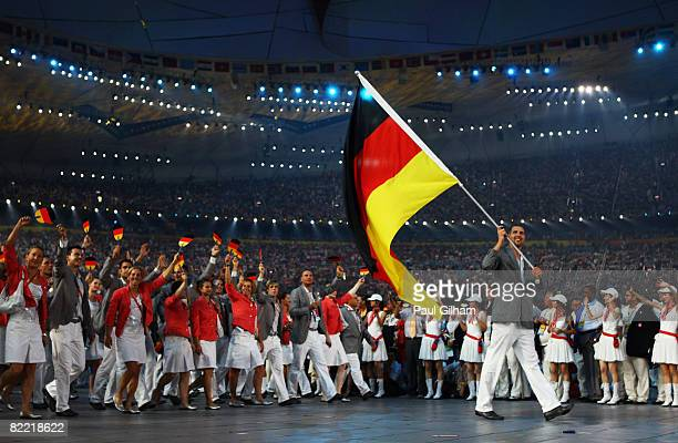 Basketball player Dirk Nowitzki of Germany leads the team while carrying his country's flag during the Opening Ceremony for the 2008 Beijing Summer...