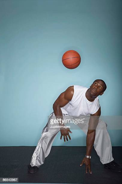 Basketball player dodging ball