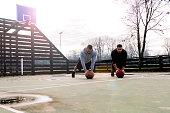 Push ups on basketball court. Basketball player doing push ups