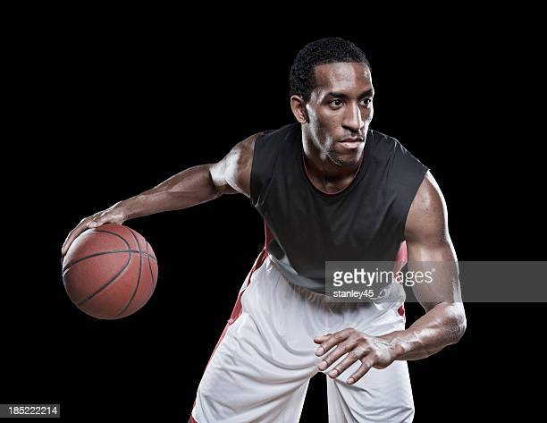Basketball player dribbling a ball