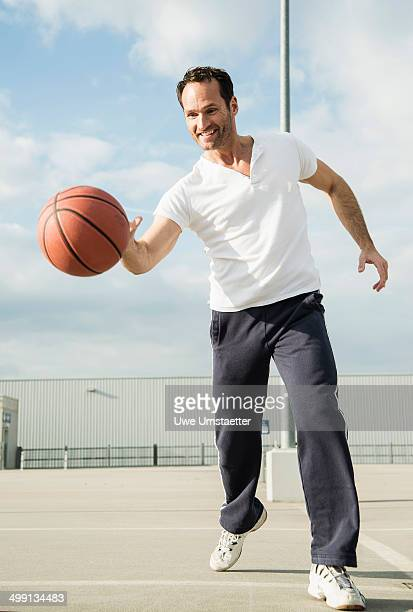 Basketball player dribbling basketball